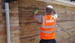 Inserting helical bar to repair cracks in wall