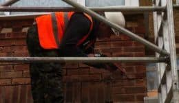 masonry-beams-being-injected-with-grout
