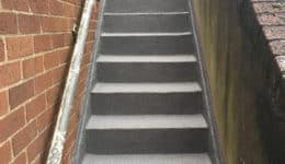 Stairwell coated with Polyac Rapid, rapid cure, anti-slip-waterproofing system.