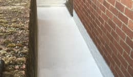 External walkway coated in Polyac Rapid prior to broadcasting with natural quartz